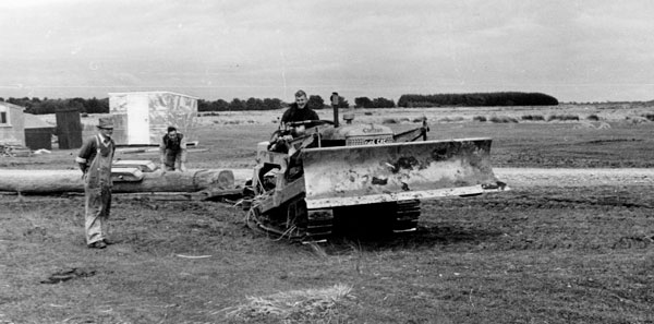 October 1951: Using a light bulldozer to drag 70ft poles into position for erection at Himatangi Radio