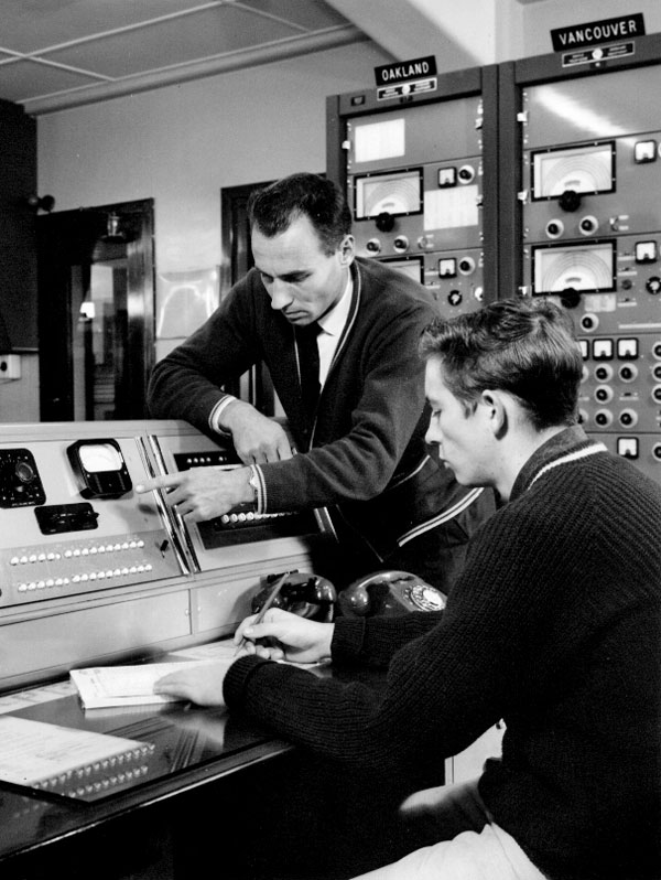 Technicians Clive Reeve (standing) and Allan Asky, Makara Radio.