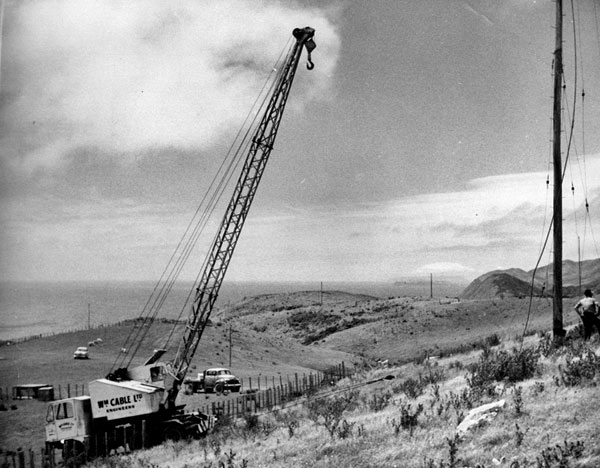 Riggers prepare to remove a pole at Makara Radio. Date unknown.