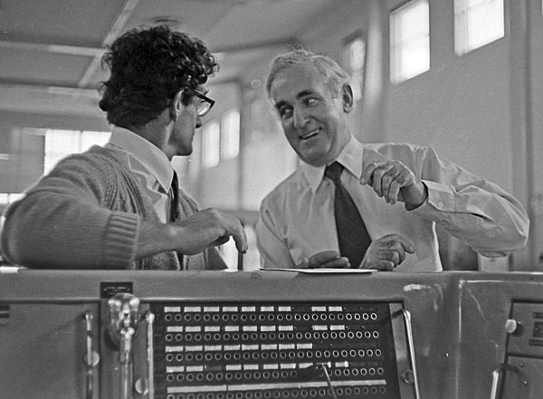 George King (right) Officer-in-Charge, Himatangi Radio shares a light-hearted moment with Deputy OIC Don Snadon at the control console, c1974