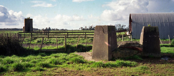 Base of the original 400' tower, and in the distance the north anchor block at Awanui