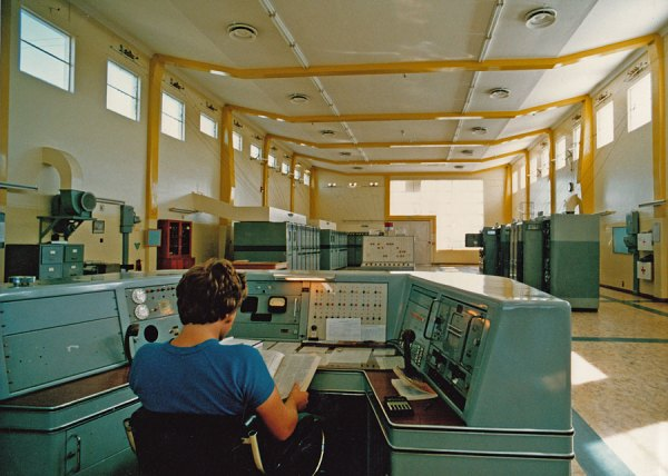 Robert Burnett at the main console in the Himatangi Radio transmitter hall. This photo was taken after changes to the indicator panels this and the aerial switching console.