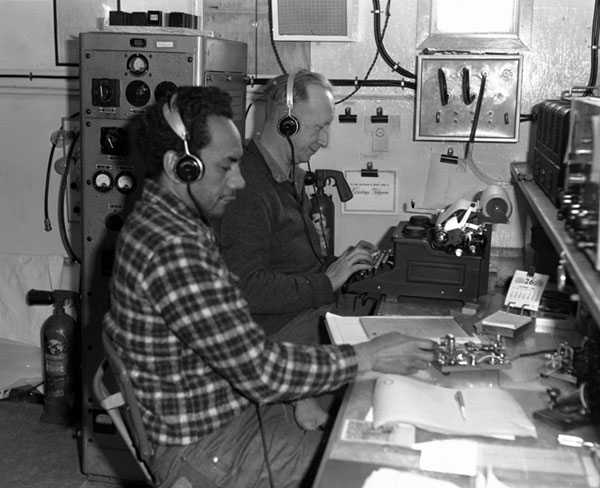 Scott Base radio operators 1964-1965. Ted Gawn at right