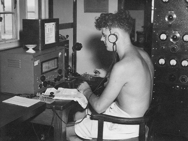 Radio operator Lloyd (Cookie) Douglas at Raoul Island Radio ZME in late November 1949