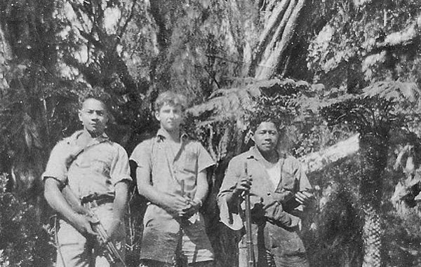 Clyde Williams and two of the Niuean men out hunting for goats. Note the density of the local jungle; most shooting was at virtually point blank range