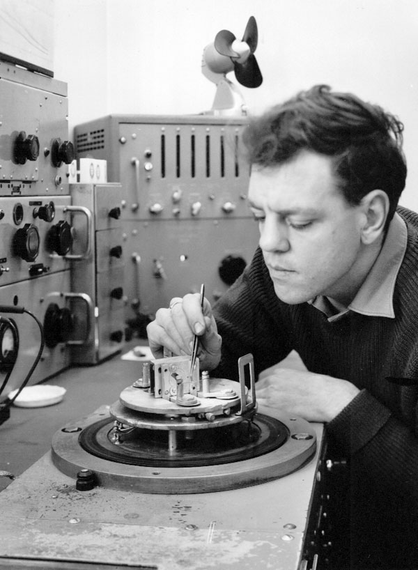Graeme Thompson seen placing small hairpin-shaped lengths of silver wire on a heating element