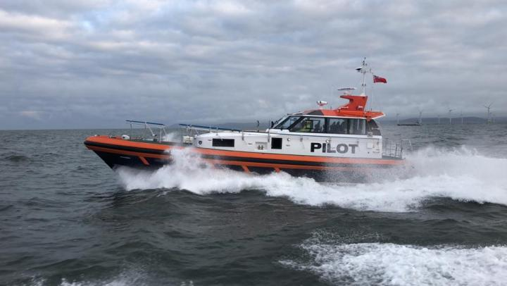 side shot of a pilot boat in the sea