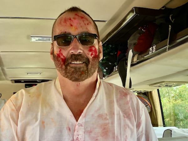 Mark and Chuck's Adventures - India Trip - Traveling in India - Traveling in India during Holi - Traveling in India during COVID 19 - Chuck covered with bright red powder from celebrating Holi