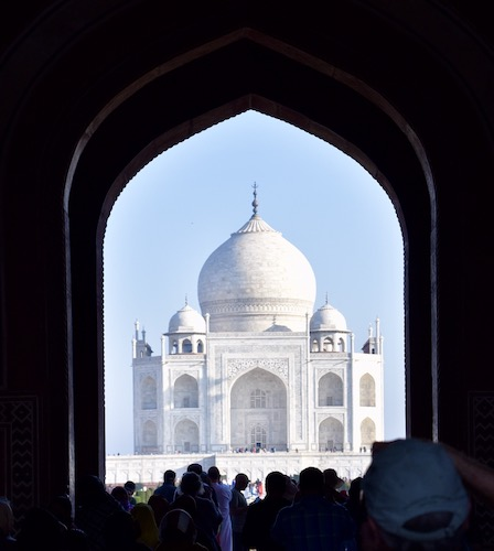 Mark and Chuck's Adventures - India trip - view of Taj Mahal though arched doorway - Taj Mahal - Seven Wonders of the World