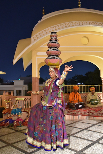 Rajasthani dance - dancer balancing five bowls on her head - local Rajasthani cultural show - Shahpura House