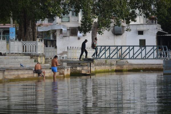 Men bathing in Lake Pichola in Udaipur