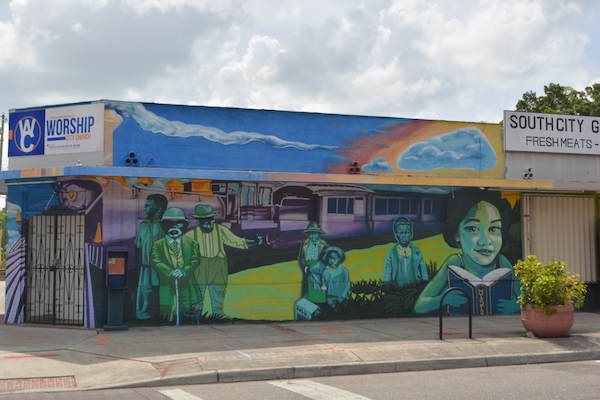black history mural wrapping church building in The Deuces