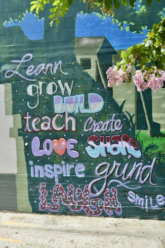 inspirational words are part of a mural by artist Zulu along the deuces in south st Pete