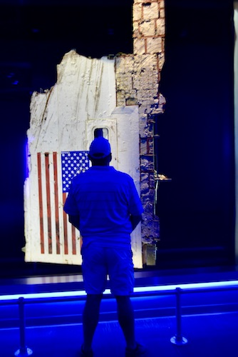 man standing in front of the friends and fallen heroes exhibit