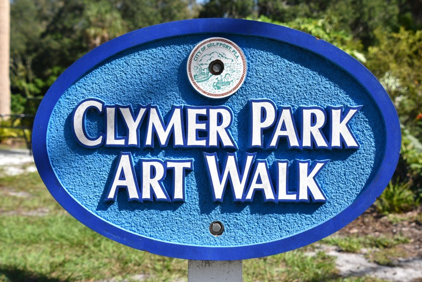 Clymer artwork sign along the walkway in Gulfport, Florida