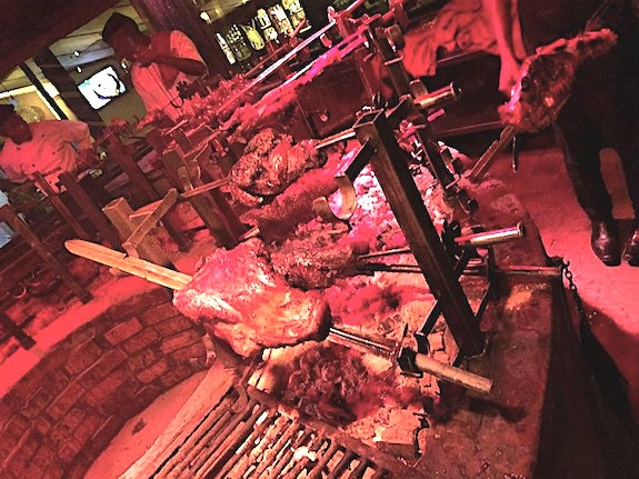 Meats roasting over a fire at Carnivore in Nairobi Kenya