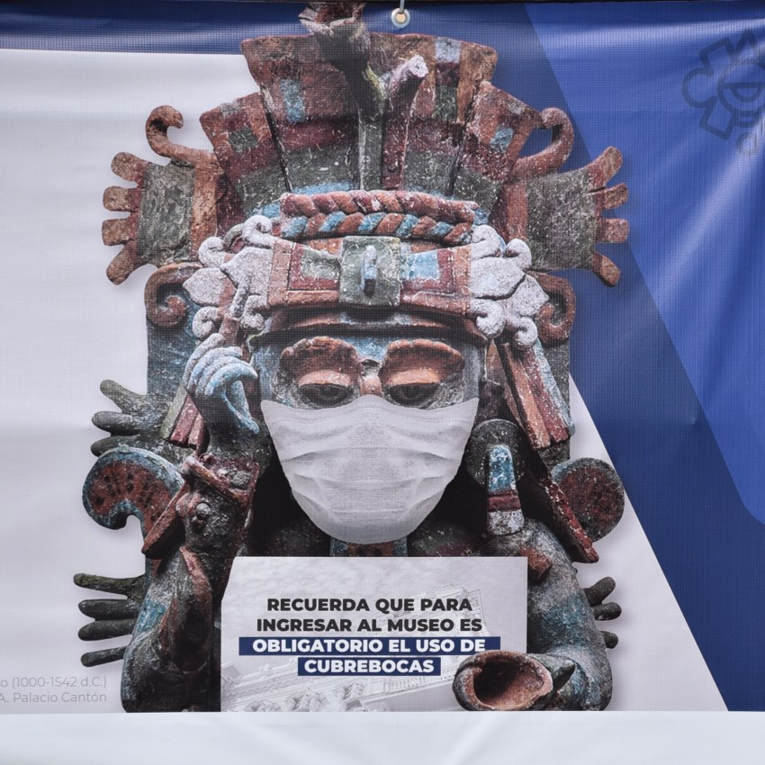 mayan stature wearing a mask as required while traveling in Merida Mexico