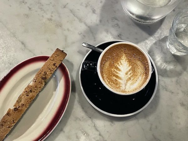 cappuccino and biscotti at Eggshell Bistro one of Carmel Indiana's unique eats