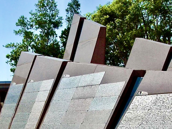 red granite walls of Walt Disney World's Leave A Legacy  at the entrance to EPCOT