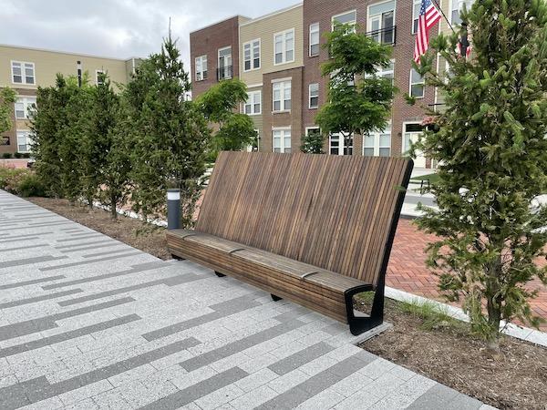 modern wooden bench along the Monon Trail