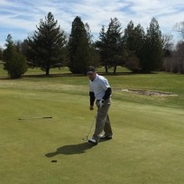 Tater stares his putt into the hole.