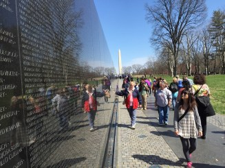Watching over the Vietnam Memorial's Wall of memories.