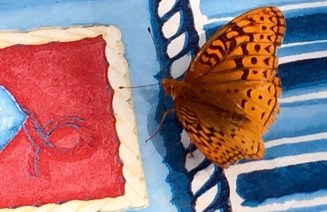 A monarch butterfly rested on our table.