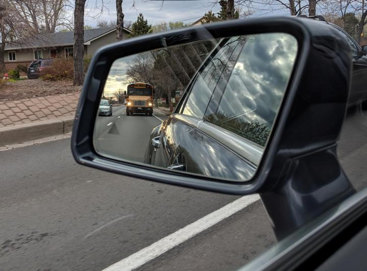 School Bus in rear view mirror