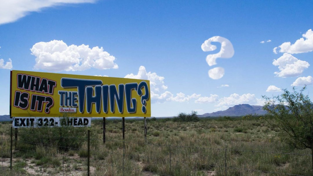 Roadside sign in Arizona desert for The Thing.