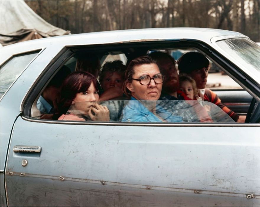 FAMILY-IN-A-CAR-IN-TENT-CITY-OUTSIDE-OF-HOUSTON-TEXAS-JANUARY-1983-by-JOEL-STERNFELD