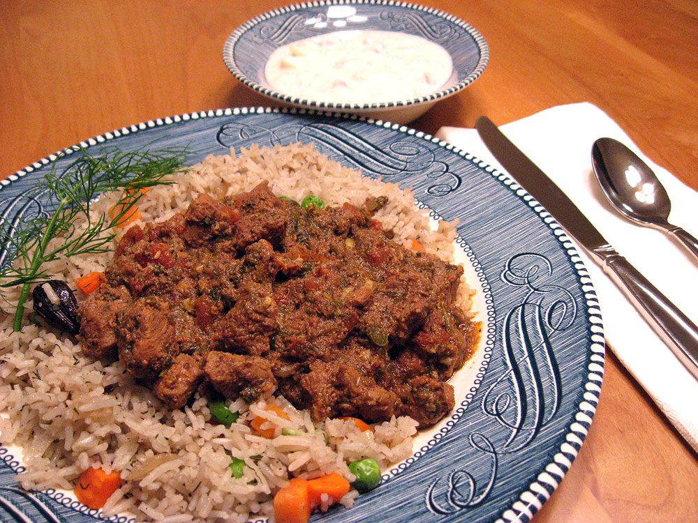 Indian cooking: Smothered Lamb, Rice with Peas and Dill, and Yogurt with Tomato and Cucumber