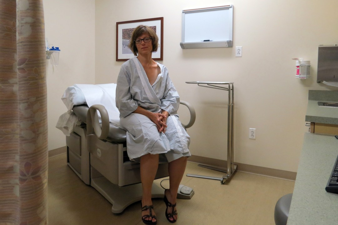 Breast cancer patient Amy Czerniec in an examining room at Froedtert Clinical Cancer Center, Milwaukee, Wisconsin