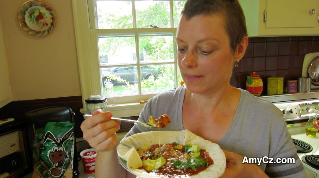 Recipe for Chicken Chili with Beans: Amy tastes her chili
