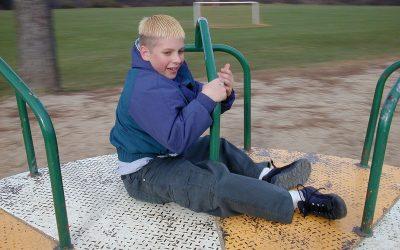 Elliot rides the merry-go-round