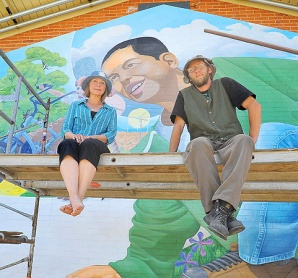 artists in front of mural in prescott, changing black, hispanic kids to white