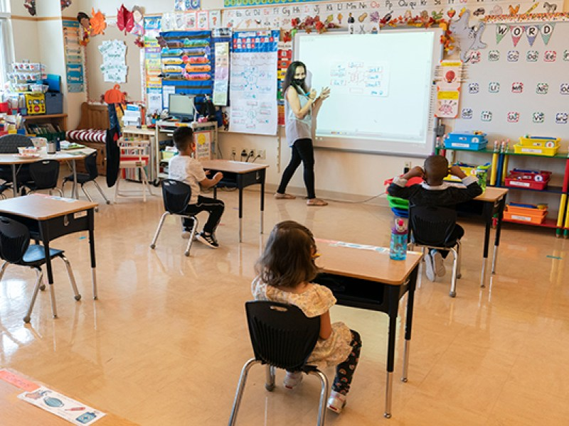 Lisa DiRenzo gives her students instructions as they sit in desks spaced for proper social distance at the Post Road Elementary School, Thursday, Oct. 1, 2020, in White Plains, N.Y. (AP Photo/Mary Altaffer)
