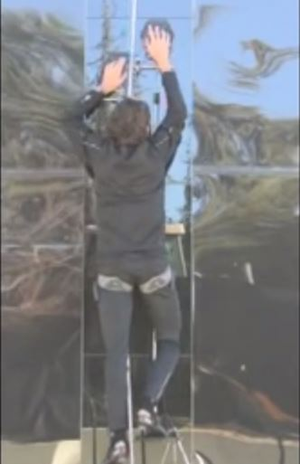 Hawkes climbing glass wall