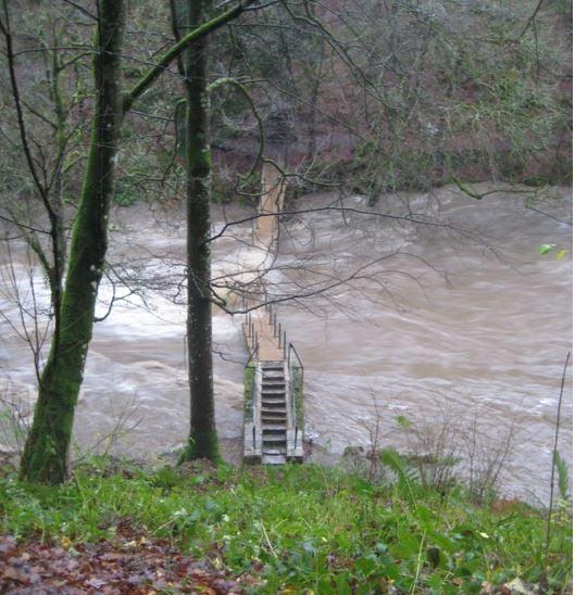 Floods destroy footbridge