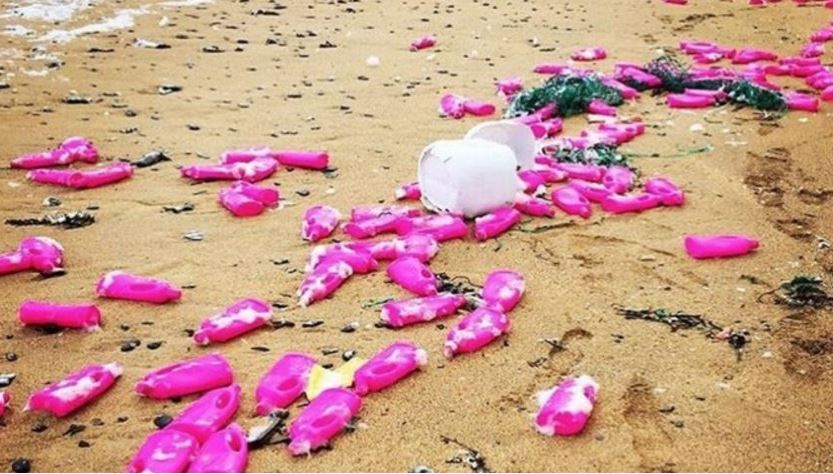 Pink plastic bottles of detergent on Cornwall beaches