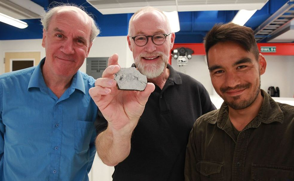 Scientists with Moon rock