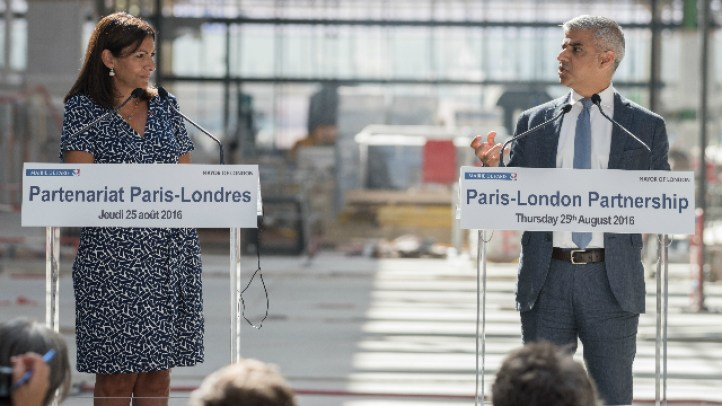 London Mayor Sadiq Khan (standing right) and the Mayor of Paris, Anne Hidalgo (standing left).