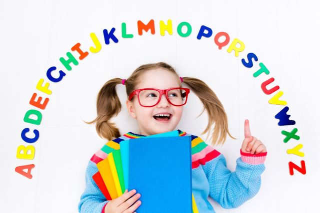 Girl Surrounded by alphabet letters