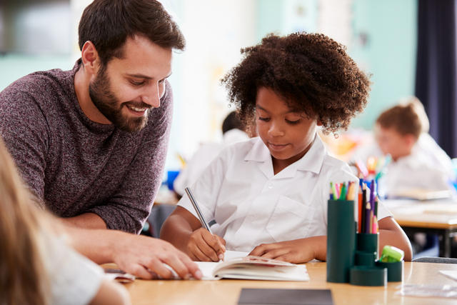 TeacherHelpingStudentWithWriting