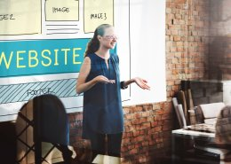 B2B website quality ranking article image header of woman discussing web development