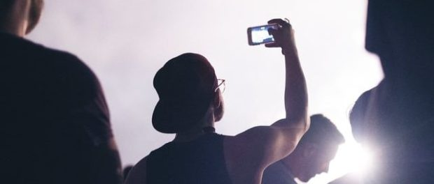 man recording a video with a smartphone