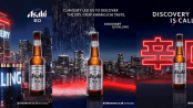 """Asahi Super Dry Japanese Beer brand, three advertisements side by side, all featuring an Asahi beer bottle and the text """"Discovery is calling"""""""