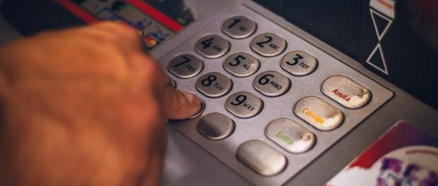 customer withrawing money at a cash machine