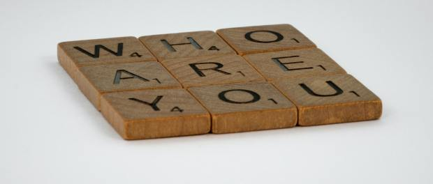Scrabble tiles spelling out 'who are you?'