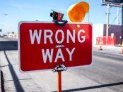 A wrong way road sign.
