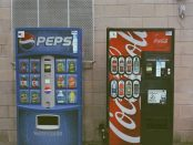 Pepsi and Coke vending machines side-by-side